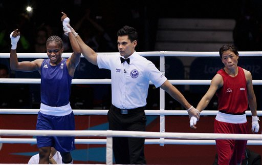 Great Britain's Nicola Adams, left, and India's Chungneijang Mery Kom Hmangte react following a women's flyweight 51-kg semifinal boxing match at the 2012 Summer Olympics