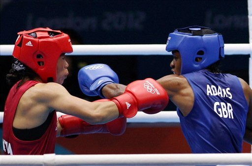 Great Britain's Nicola Adams, right, and India's Chungneijang Mery Kom Hmangte fight during their women's flyweight 51-kg semifinal boxing match
