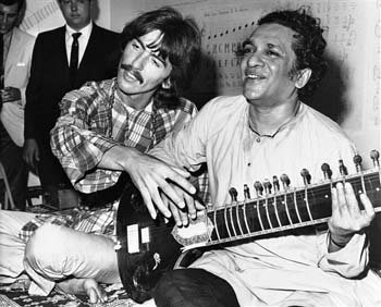 George Harrison, of the Beatles, left, sits cross-legged with his musical mentor, Ravi Shankar