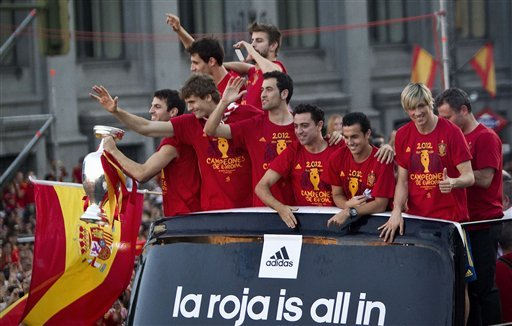 Spain's  soccer team players show the Euro cup as they wave to supporters at Cibeles Square in Madrid, Spain