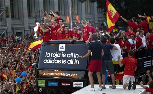 Spain's  soccer team players show the Euro cup as they wave to supporters at Cibeles Square in Madrid,
