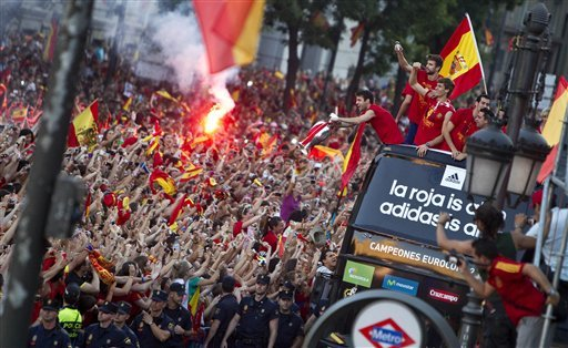 Spain  players show the Euro cup as they wave supporters at Cibeles Square in Madrid, Spain