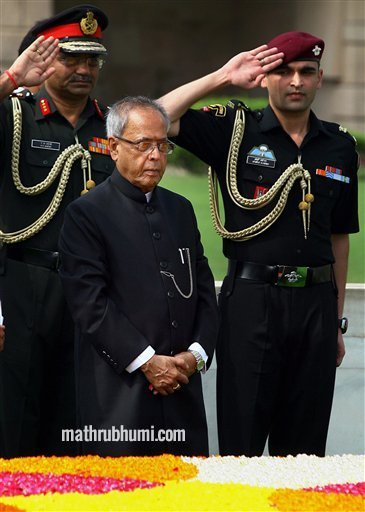 <br/> New Delhi: President-elect Pranab Mukherjee pays homage at Rajghat before taking oath as India's 13th President, in New Delhi on Wednesday. PTI <br/>