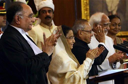 New Delhi: President Pranab Mukherjee gestures after taking oath as 13th President of India as his predecessor Pratibha Patil, Vice President Hamid Ansari, Chief Justice of India SH Kapadia and Lok Sabha Speaker Meira Kumar applaud at a special ceremony in the Central Hall of Parliament in New Delhi on Wednesday. PTI Photo by Shahbaz Khan<br/>