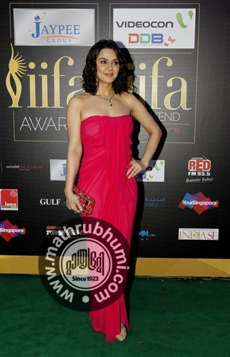 Bollywood actress Priti Zinta arrives on the 'green carpet' for the Jaypee International Indian Film Academy (IIFA) awards held on Saturday June 9, 2012 in Singapore