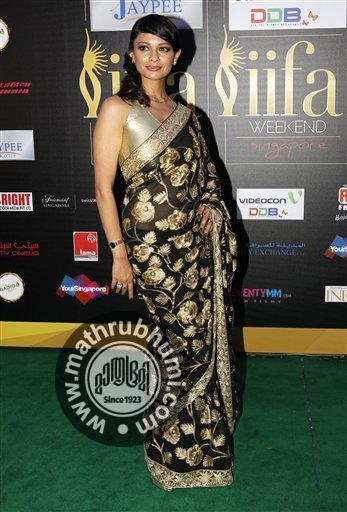 Bollywood actresses Pooja Kumar, arrives on the 'green carpet' for the Jaypee International Indian Film Academy (IIFA) awards held on Saturday June 9, 2012 in Singapore
