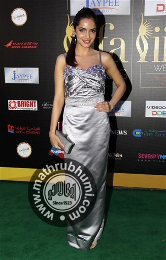 Bollywood actress Shazahn Padamsee arrives on the 'green carpet' for the Jaypee International Indian Film Academy (IIFA) awards held on Saturday June 9, 2012 in Singapore