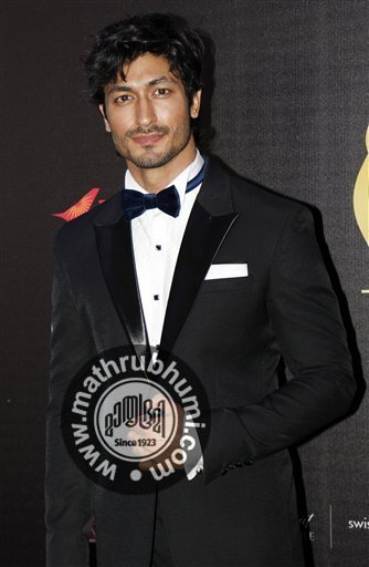 Bollywood actor Vidyut Jamwal arrives on the 'green carpet' for the Jaypee International Indian Film Academy (IIFA) awards held on Saturday June 9, 2012 in Singapore<br/>