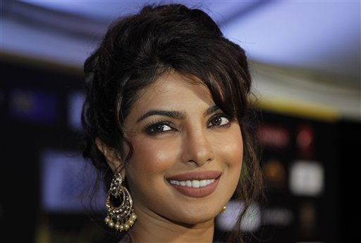 Bollywood actress Chitrangada Singh arrives on the 'green carpet' for the Jaypee International Indian Film Academy (IIFA) awards held on Saturday June 9, 2012 in Singapore<br/>