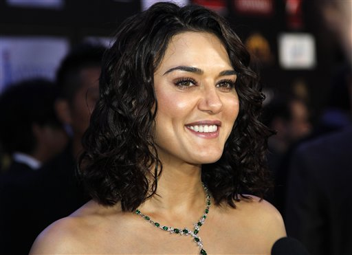 Bollywood actress Priti Zinta arrives on the 'green carpet' for the Jaypee International Indian Film Academy (IIFA) awards held on Saturday June 9, 2012 in Singapore<br/>