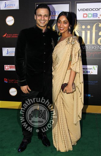 Bollywood actor Vivek Oberoi, left, and his wife Priyanka, arrive on the 'green carpet' for the Jaypee International Indian Film Academy (IIFA) awards held on Saturday June 9, 2012 in Singapore