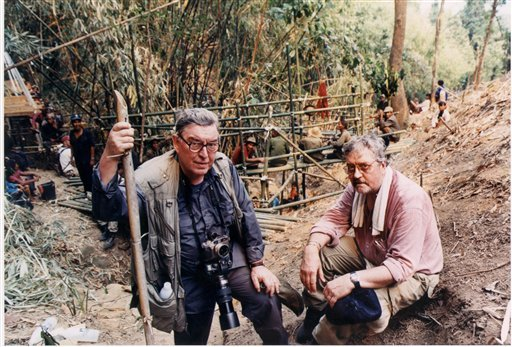 Horst Faas, left, and former AP Saigon bureau chief Richard Pyle pose at a Laos crash site, as a U.S.