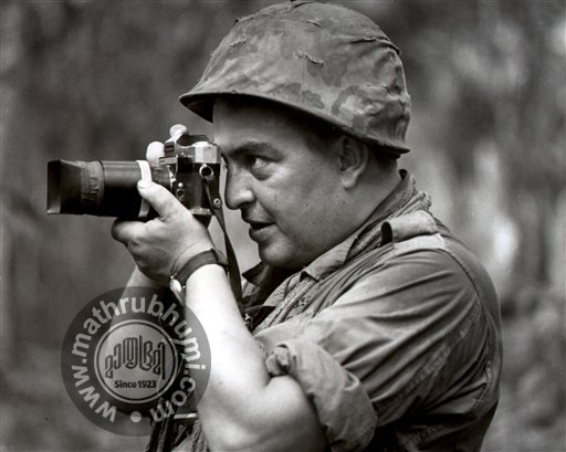 In this 1967 file photo Associated Press photographer Horst Faas works in Vietnam. Faas, a prize-winning combat photographer who carved out new standards for covering war with a camera and became one of the world's legendary photojournalists in nearl