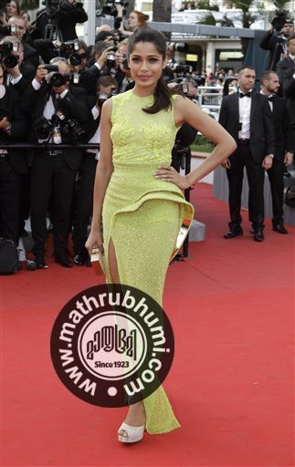 Actress Freida Pinto arrives for the screening of Rust and Bone at the 65th international film festival, in Cannes, southern France, Thursday, May 17, 2012<br/>