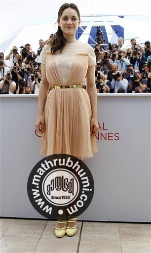 Actress Marion Cotillard poses during a photo call for Rust and Bone at the 65th international film festival, in Cannes, southern France, Thursday, May 17, 2012