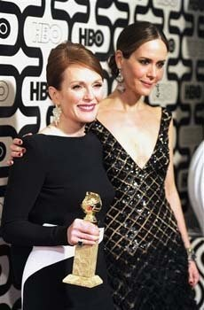 Actress Julianne Moore, winner of the award for best actress in a miniseries for 'Game Change,' left, and Sarah Paulson arrive at the HBO Golden Globe