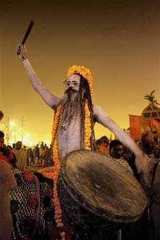 Hindu holy men, or Naga Sadhus, celebrate naked in the water at Sangam