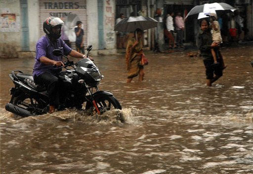 Torrential rain and floods washed away buildings and roads in Uttarakhand