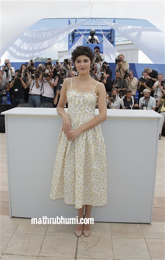 Actress Audrey Tautou, who will host the Cannes Film Festival opening ceremony on Wednesday, poses for photographers at the 66th international film festival, in Cannes, southern France, Tuesday, May 14, 2013. (AP