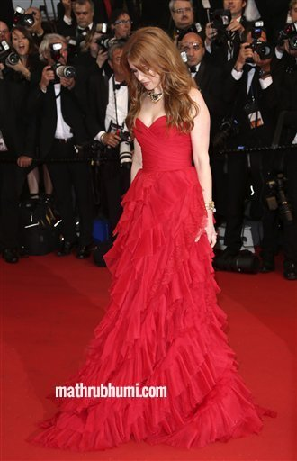 Actress Isla Fisher arrives for the opening ceremony and the screening of The Great Gatsby at the 66th international film festival, in Cannes, southern France, Wednesday, May 15, 2013