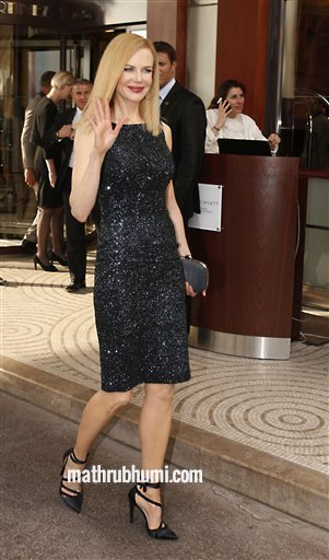 Actress and jury member Nicole Kidman arrives for cocktails at the Martinez Hotel at the 66th international film festival, in Cannes, southern France, Tuesday, May 14, 2013